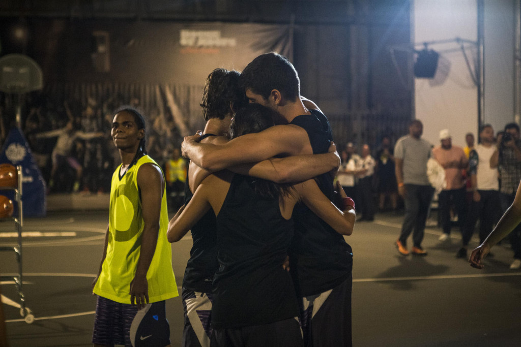Victory. Young basketball players celebrate a win in the court's inaugural 3-on-3 tournament.