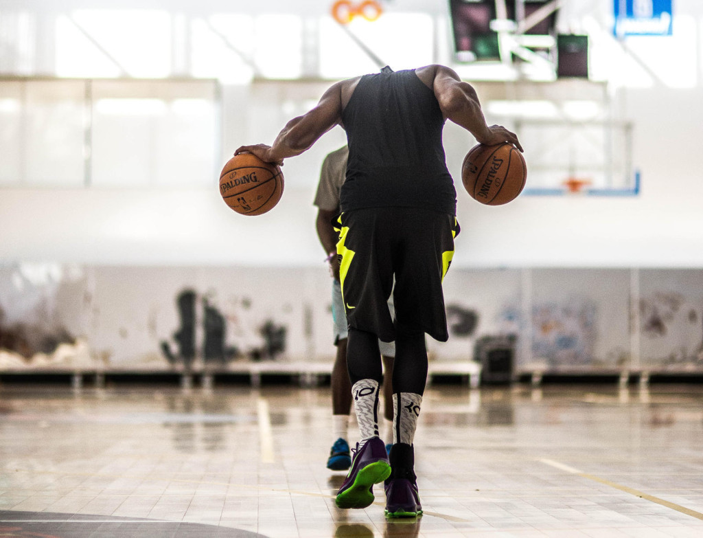 Durant grinds out drills to begin an early Saturday morning training session.