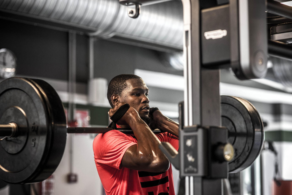 Durant lifts weights at a local gym following on-court drills and shooting.