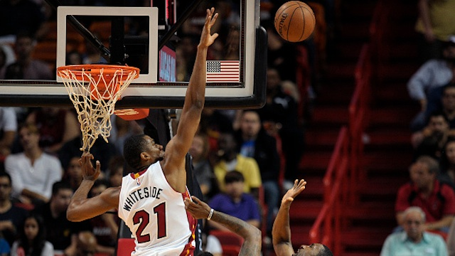 Hassan Whiteside goes up for a shot block.