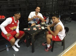 The San Miguel Beermen chill out after practice by playing Monopoly Deal
