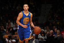 LOOK: Stephen Curry hits a half-court shot…on a PhunkeeDuck